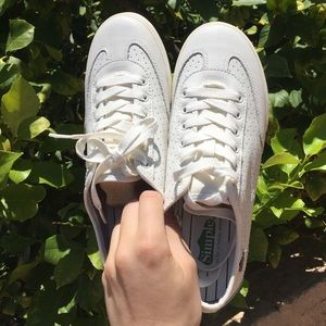 White Simple brand tennis shoes